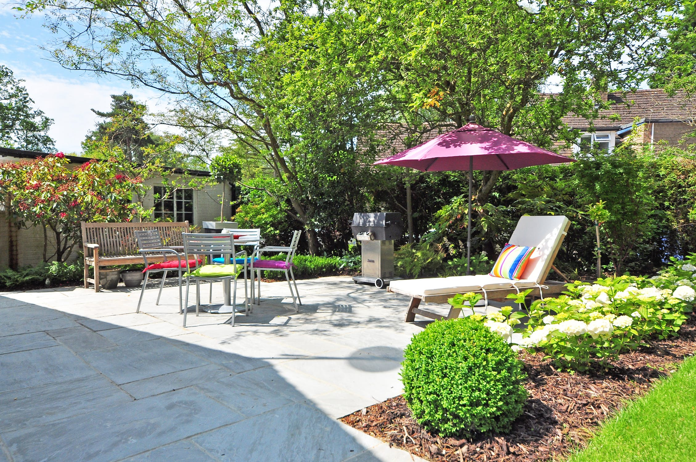 Garden landscaping - outdoor recreation area with shrubs, flowers and paving